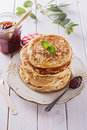Healthy oat pancakes over white wooden background stack of low carbs and jam Royalty Free Stock Image