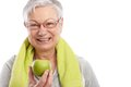 Healthy old woman with green apple smiling Royalty Free Stock Photo