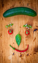 Healthy organic vegetables on a wooden background art smiley design Royalty Free Stock Photography