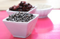 Healthy raw chocloate dried cranberries table Royalty Free Stock Image