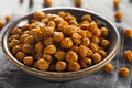 Healthy roasted seasoned chick peas with different spices Royalty Free Stock Photos