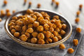 Healthy roasted seasoned chick peas with different spices Royalty Free Stock Photo