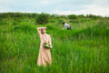 The healthy rural life. The woman in the green field Royalty Free Stock Photo