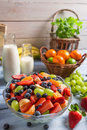 Healthy salad made of fresh fruits on old wooden table Stock Image