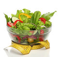 Healthy salad and a measuring tape isolated Royalty Free Stock Images
