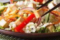 Healthy salad tofu and vegetables with chopsticks macro Royalty Free Stock Photo