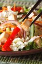 Healthy salad tofu and vegetables with chopsticks macro vertical Royalty Free Stock Photo