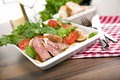 Healthy salad w/ roast beef, arugula, figs, tomato Royalty Free Stock Image