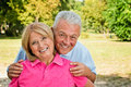 Healthy senior couple enjoy posing outdoors feeling Stock Images