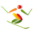 Healthy slalom fruits and vegetables in the shape of a skier sliding downhill Stock Photography