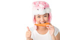Healthy snack vertical portrait of cute teenager in bunny hat heaving a Stock Photography