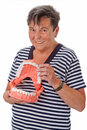 Healthy teeth senior woman with dentures isolated Stock Image