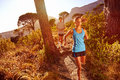 Healthy trail running marathon athlete outdoors sunrise couple training for fitness and lifestyle Stock Images
