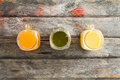 Healthy tropical fruit juice on a picnic table Royalty Free Stock Photo