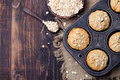 Healthy vegan oat muffins, apple and banana cakes in vintage pan. Top view. Copy space Royalty Free Stock Photo