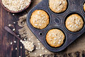 Healthy vegan oat muffins, apple and banana cakes in vintage pan Top view Royalty Free Stock Photo