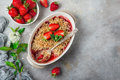 Healthy vegan rhubarb and strawberry  oats crumble pie for break Royalty Free Stock Photo
