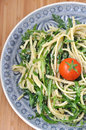 Healthy vegan spaghetti with rucola and tomatoes Royalty Free Stock Image