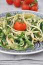 Healthy vegan spaghetti with rucola and tomatoes Royalty Free Stock Photos
