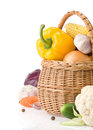 Healthy vegetable food and basket on white Stock Photography