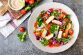 Healthy vegetable salad with grilled chicken breast, fresh lettuce, cherry tomatoes, red onion and pepper Royalty Free Stock Photo