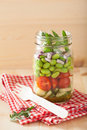 Healthy vegetable salad in mason jar: tomato, cucumber, soybean, Royalty Free Stock Photo