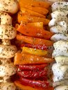 Healthy vegetable skewers ready to grill, nutritious red orange and yellow peppers with mushrooms and onions Royalty Free Stock Photo