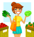 Healthy vegetables young woman buying in the market Royalty Free Stock Photo