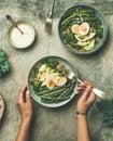Healthy vegetarian breakfast bowls over grey concrete background