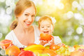 Healthy vegetarian food. happy family mother and baby daughter w