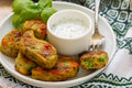 Healthy vegetarian potato patties with carrots, broccoli, bell pepper, green peas and onions with sour cream sauce with dill and B Royalty Free Stock Photo