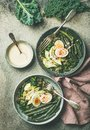 Healthy vegetarian breakfast bowls over concrete background, copy space