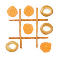Healthy vs unhealthy food tic tac toe game carrots versus bagels Stock Photo