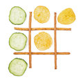 Healthy vs unhealthy food tic tac toe game cucumber versus potato chips Stock Image