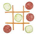 Healthy vs unhealthy food tic tac toe game cucumber versus salami Stock Images