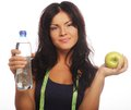Healthy woman with apple and bottle of water portrait a isolated on white Stock Image