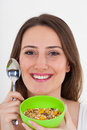 Healthy woman eating cereal Royalty Free Stock Photo