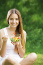 Healthy woman eating salad Stock Image