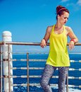 Healthy woman in fitness outfit looking aside at embankment Royalty Free Stock Photo