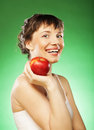 Healthy woman with fresh red apple