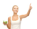Healthy woman holding bowl with salad and ponting her finger Stock Images
