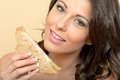 Healthy Woman Holding Half a Prawn Sandwich on Brown Bread Royalty Free Stock Photo