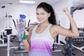 Healthy woman holds bottle of mineral water Royalty Free Stock Photo