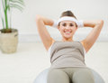 Healthy woman making abdominal crunch on ball Royalty Free Stock Photography