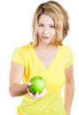 Healthy woman nutritionist or fitness trainer holding and offering an apple as a healthy alternative close up portrait of Stock Photography
