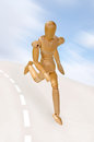 Healthy wooden man running fast on road playing sports
