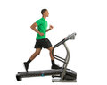 Healthy young african american running in treadmill isolated on white background Royalty Free Stock Photography