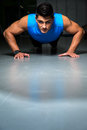Healthy young guy doing push up exercise portrait of a ups Stock Photo