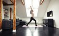 Healthy young lady going yoga workout at home full length portrait of fitness model exercising in living room Royalty Free Stock Images