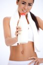 Healthy young woman with a bottle of milk Royalty Free Stock Photo